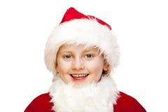 El niño joven de Papá Noel con el casquillo de la piel sonríe feliz Fotografía de archivo libre de regalías