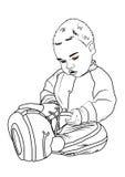 El niño mira los juguete-zapatos Fotos de archivo