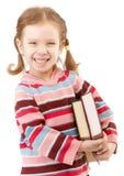 El niño preescolar agradable sostiene los libros de textos Fotos de archivo libres de regalías