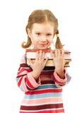 El niño preescolar agradable sostiene los libros de textos Fotos de archivo
