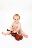 El niño que juega con un violín Imagen de archivo