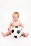 El niño que juega con una bola Imágenes de archivo libres de regalías