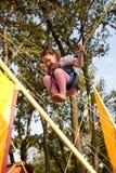 El niño que salta en el trampolín Foto de archivo libre de regalías
