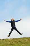 El niño que salta para la alegría Fotografía de archivo