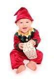 El niño se vistió en traje del vestido de lujo del ayudante de santas de los elfs pequeño Fotos de archivo