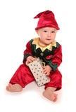 El niño se vistió en traje del vestido de lujo del ayudante de santas de los elfs pequeño Fotografía de archivo