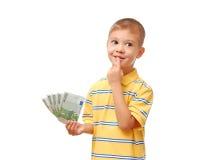El niño sostiene el dinero Imagen de archivo