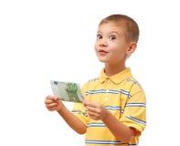 El niño sostiene el dinero Foto de archivo libre de regalías