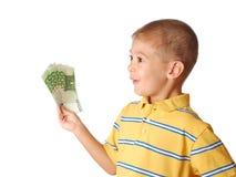 El niño sostiene el dinero Imágenes de archivo libres de regalías