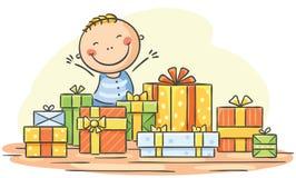 El niño tiene demasiados presentes Imagen de archivo libre de regalías