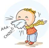 El niño tiene gripe y está estornudando Imagen de archivo