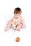 El niño y la manzana Foto de archivo libre de regalías