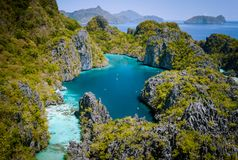 El Nido, Palawan, Philippines. Aerial drone view of beautiful big lagoon surrounded by karst limestone cliffs. Tourists. Explore area on kayaks stock photos