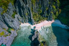 Free El Nido, Palawan, Philippines. Aerial View Of Secret Hidden Lagoon Beach With Tourist Banca Boats On Island Hopping Tour Stock Photo - 161065700