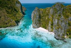 Free El Nido, Palawan, Philippines. Aerial View Of Tropical Sea Stack Island With Tourist Boats Moored At White Sandy Beach Stock Photos - 161065713