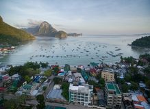 El Nido, Palawan, Philippines. Sunrise Light with Boats on Water. El Nido, Palawan, Philippines. Sunrise Light Royalty Free Stock Images