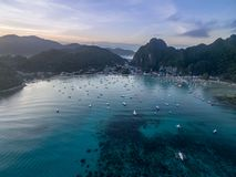 El Nido, Palawan, Philippines. Sunrise Light with Boats on Water. Mountain in Background. El Nido, Palawan, Philippines. Sunrise Light Royalty Free Stock Photos