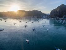 El Nido, Palawan, Philippines. Sunrise Light with Boats on Water. El Nido, Palawan, Philippines. Sunrise Light Royalty Free Stock Photos