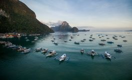 El Nido, Palawan, Philippines. Sunrise Light with Boats on Water. Mountain in Background. El Nido, Palawan, Philippines. Sunrise Light Royalty Free Stock Image