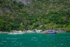 Landscape of tropical sea at sunny day. El Nido, Philippines - Apr 7, 2017. Small village with many wooden boats in El Nido, Philippines. El Nido is a coastal stock image