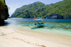 El Nido, Philippines - banca on the beach, Tapiutan island. El Nido, Palawan, Philippines - banca on the beach, Tapiutan island Royalty Free Stock Images