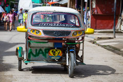 El Nido, Philippines. FEBRUARY 2, 2014 :Tricycle motor taxi, Philippines inexpensive transport service. Tricycle motor taxi are the most popular means of Royalty Free Stock Image