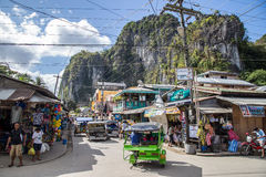El Nido streets and shops. Busy centre of El Nido with lots of shops, bars and restaurant as well as heavy traffic in the narrow streets. There aren't many cars stock image