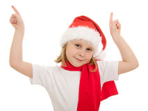El niño de la feliz Navidad señala su dedo hacia arriba Fotos de archivo