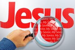 El nombre JESÚS bajo observación con la lupa Fotos de archivo