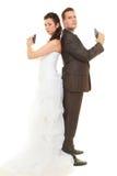 El novio y la novia en la boda equipan sostener los armas Fotografía de archivo libre de regalías