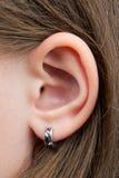 El oído de la niña Fotografía de archivo libre de regalías
