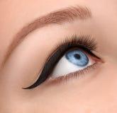 El ojo del encanto compone cerca con la flecha negra Fotografía de archivo