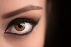 El ojo morado del encanto compone con la flecha ancha Fotos de archivo