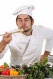 El oler joven del cocinero Fotografía de archivo libre de regalías
