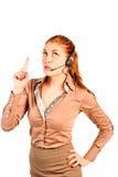 El operador de la muchacha comunica con el cliente Foto de archivo libre de regalías