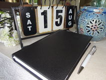 El orden del día, styluspen y hace calendarios Foto de archivo libre de regalías