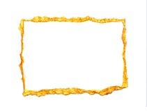 El oro abstracto pintó el marco en un fondo blanco con el lugar para su texto Foto de archivo