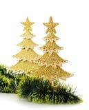 El oro adornó los árboles de navidad y el objeto del día de fiesta Foto de archivo
