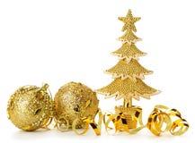 El oro adornó los árboles de navidad y el objeto del día de fiesta Foto de archivo libre de regalías