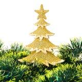 El oro adornó los árboles de navidad y el objeto del día de fiesta Imagen de archivo