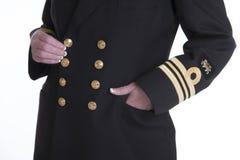El oro coloreó los botones y la trenza en un uniforme Fotos de archivo