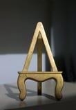 El oro doró la base Foto de archivo