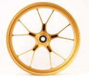 El oro forjó las ruedas Fotografía de archivo