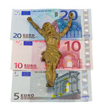 El oro Jesús del concepto crucifica los billetes de banco euro aislados Foto de archivo libre de regalías