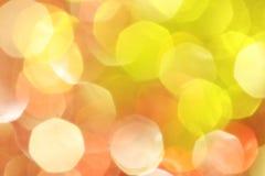 El oro, plata, rojo, blanco, bokeh abstracto anaranjado se enciende, fondo defocused fotografía de archivo libre de regalías
