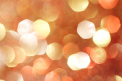 El oro, plata, rojo, blanco, bokeh abstracto anaranjado se enciende, fondo defocused fotos de archivo