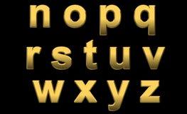 El oro pone letras al n-z minúsculo Imágenes de archivo libres de regalías