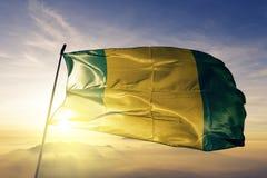 El Oro Province of Ecuador flag textile cloth fabric waving on the top sunrise mist fog. Beautiful stock image