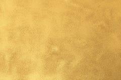 El oro texturizó el fondo superficial con reflejos de luz ilustración del vector