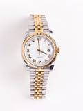 El oro y el acero inoxidable sirve el reloj Imágenes de archivo libres de regalías